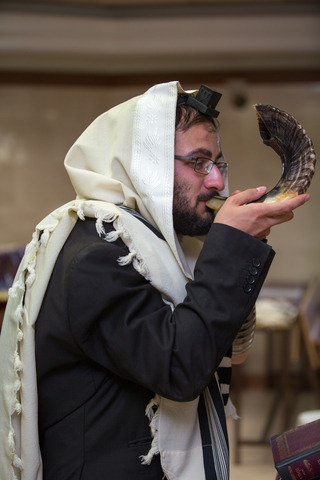 © Moshechaim | Dreamstime.com - Orthodox Jew Blow The Shofar Photo