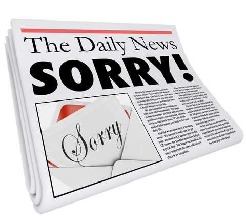 Sorry word in a newspaper headline to communicate a message of apology for bad reporting or an error in an article