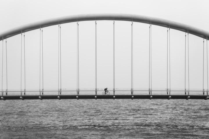 bicycle across bridge